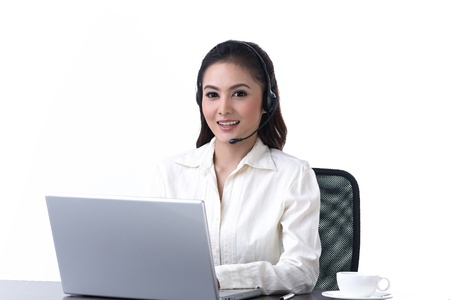 A call center woman with headset talking with customer