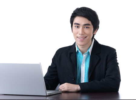 Young business man working happily with laptop photo
