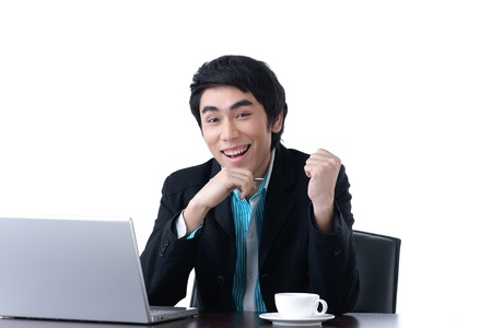 great job: Young business man very happy with his success work Stock Photo