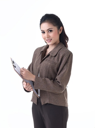 Beautiful business woman working on paper photo