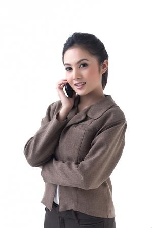 Jolie femme d'affaires est au téléphone Banque d'images