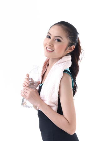 Young woman holding a bottle of water photo
