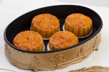 Moon cakes in beautiful box, traditional dessert for the Chinese mid autumn festival photo