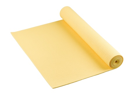yoga mat:  Yellow yoga mat nice for exercise at home or gym  Stock Photo