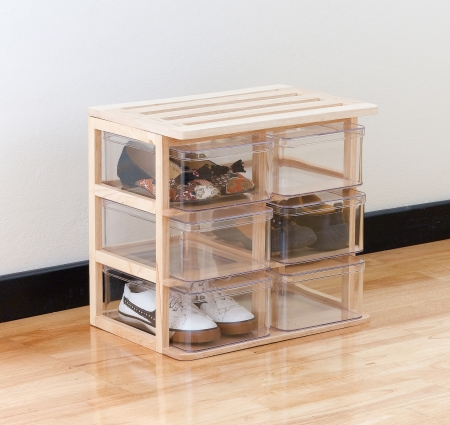 A modern design of shoe boxes on a wooden stand for storage the shoes