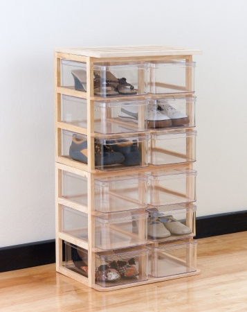 home keeping: A modern design of shoe boxes on a wooden stand for storage the shoes