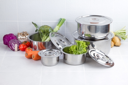stainless steel pot: Set of stainless pots with lids and vegetables