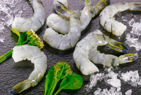 Group of raw shrimps with vegetable photo