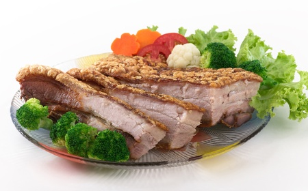 Fried crispy pork served with vegetable photo
