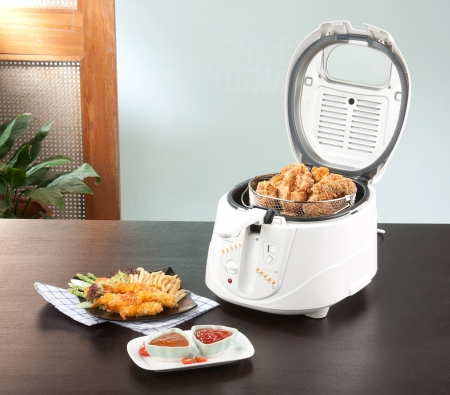 fryer:  Lets do your chicken fried by using deep fryer machine comfortable and fast Stock Photo