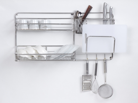 Stainless shelf with kitchen utensil on the white background photo