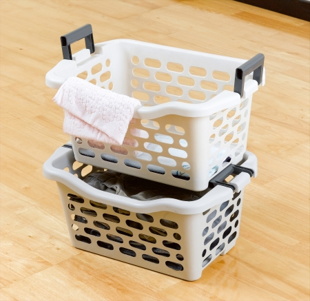 Stack of plastic baskets for laundry photo