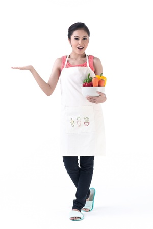 housewife holding a bowl of vegetable and other hand holding your product with feeling wonderful