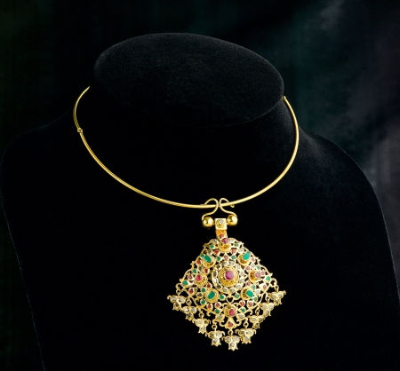 antique jewelry:  Thai ancient style golden necklace with pendant decorated by gemstone