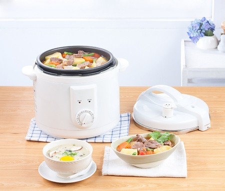 Rice cooking and electric casserole pot very importance kitchenware photo