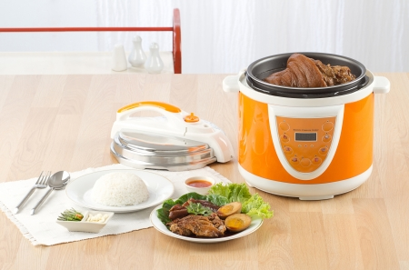 Electric pressure cooker new technology for cooking Archivio Fotografico