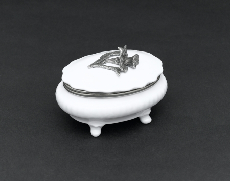 A luxury porcelain sugar bowl with a lid for tea or coffee time photo