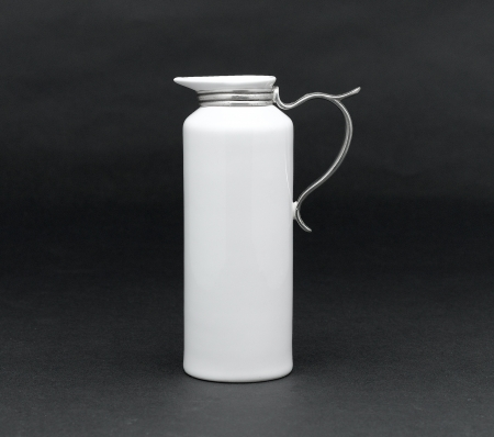 A porcelain pitcher for milk, syrup or water Stock Photo - 17037614