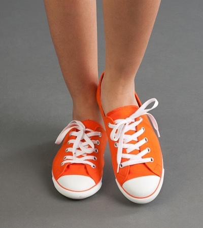 A comfortable woman sport shoe or sneaker in orange color photo