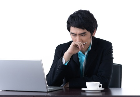 A young business man worrying about his work with laptop computer Stock Photo - 17107209