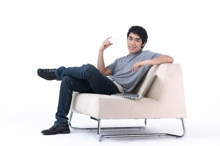 man in chair: Young man holding a blank white card for you to put some text on it Stock Photo
