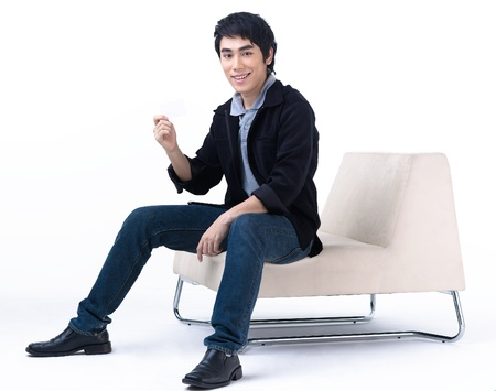 asian style:  Young man holding a blank white card for you to put some text on it Stock Photo