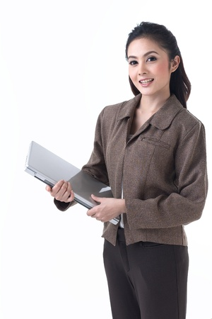 A beautiful asian business woman standing with laptop photo