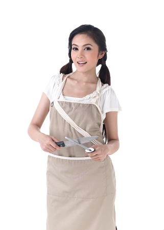 girl with knife: A housewife sharpening a knife with steel sharpener Stock Photo