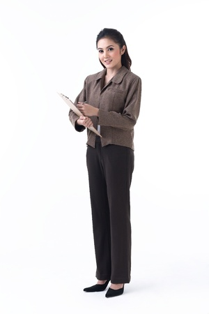 Asian business woman holding a clipboard and prepare to write photo