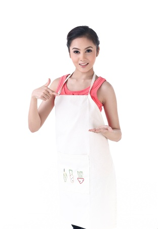 A housewife pointing to her empty hand which holding your product photo