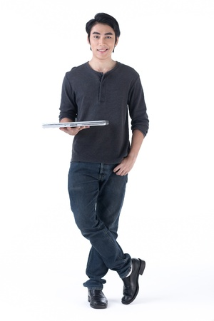 ordinary: A happy asian man standing and hold laptop computer in his hand