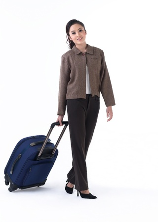 A young woman pulling her luggage Stock Photo