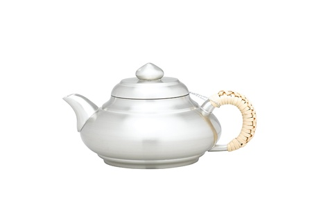 pewter mug: A little teapot made of pewter good for your tea time Stock Photo