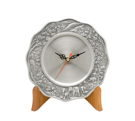 pewter: Beautiful plate clock made of pewter on wood stand Stock Photo