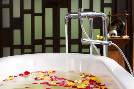 Luxury bath tub with water and flowers Stock Photo - 17342387