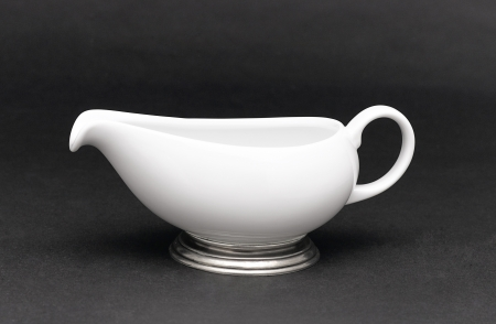 pewter: A porcelain pitcher for milk , tea or coffee decorated by pewter