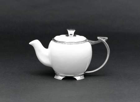 A luxury porcelain teapot with pewter handle photo