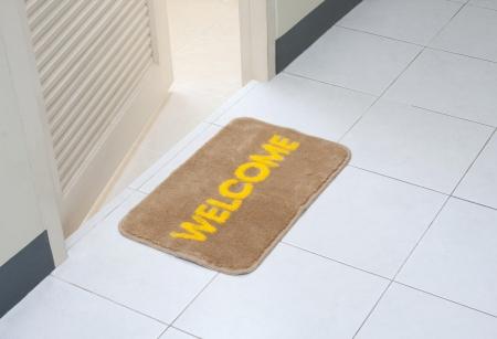 Welcome doormat in front of the rest room