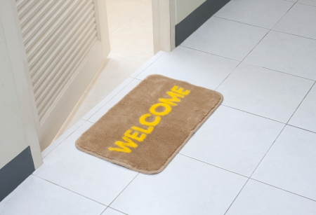 welcome door: Welcome doormat in front of the rest room