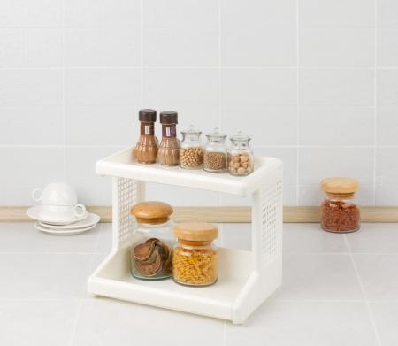 Plastic shelf with different seasonings bottles photo