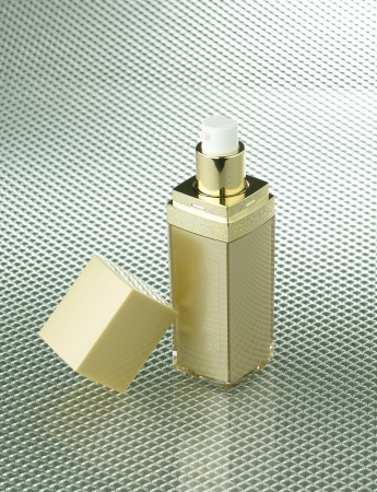 prettify: golden cosmetic bottle with blank label