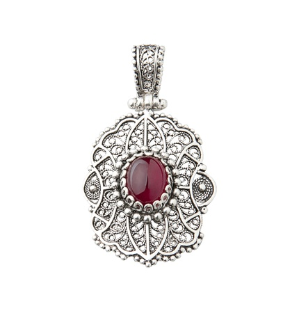 ancient israel: Beautiful silver pendant decorated by red gemstone Stock Photo