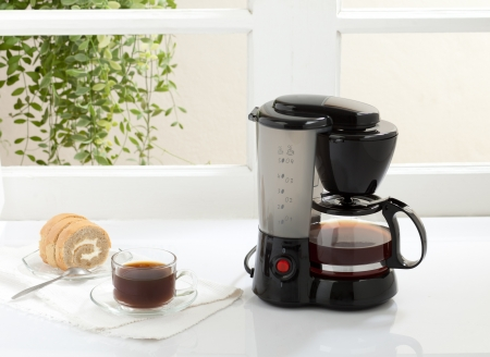 Enjoy your breakfast or coffee break with coffee maker and boiler machine