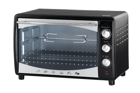 stainless steel kitchen: An electric oven for roasted chicken or baked bread Stock Photo