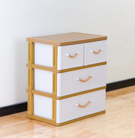 separate: Stacks of plastic drawers for home or office using Stock Photo