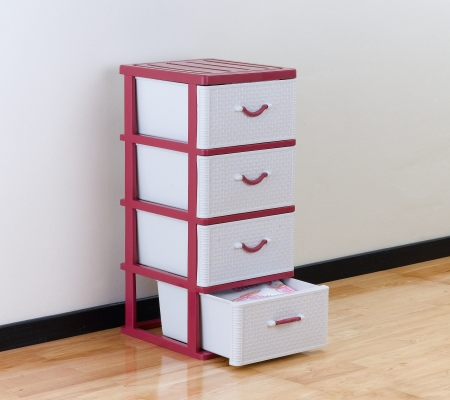A plastic cabinet with drawers
