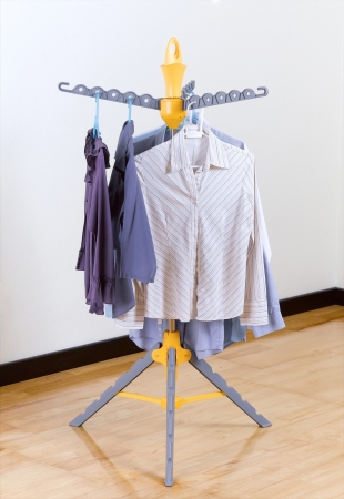 clothing rack: A plastic fold able cloth hanger for home use