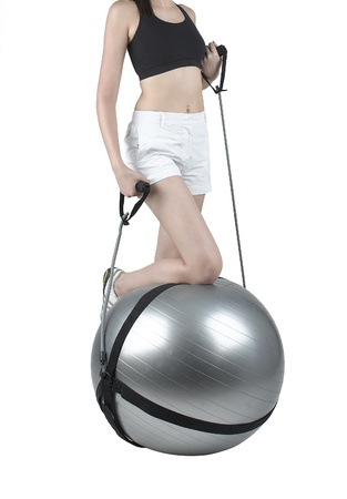 expander: A woman exercise with gym ball and expander Stock Photo