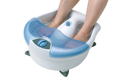 Womans feet in a vibrating feet massager Stock Photo