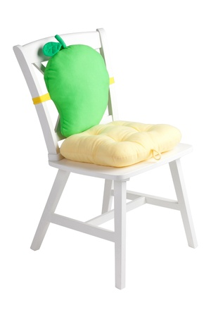 hassock: A wooden white chair with a cute cushion and pad Stock Photo